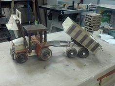 This Tractor/Trailer Combo is a companion piece(s) to the combine I posted a couple weeks ago. I have to tell ya folks, this tractor DID NOT WANT TO BE BUILT! I started it several weeks ago, then got so frustrated with it I put it away, un. Wooden Toy Farm, Woodworking Toys, Wood Toys, Joinery, Wood Projects, Tractors, Kids Toys, Farming, Trucks