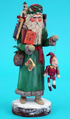 Santa folk art carving, hand carved Santas, From the Whimsical Whittler. Available on line.
