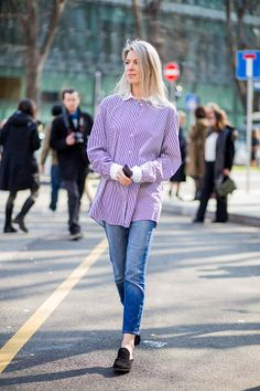 Sarah Harris wearing a pink button skirt denim jeans outside Armani during Milan Fashion Week Fall/Winter 2017/18 on February 27 2017 in Milan Italy