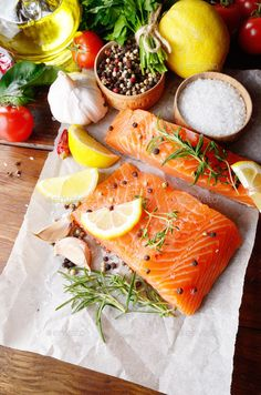 Raw salmon on baking paper by e_mikh. Raw salmon fillet with rosemary pepper sweetbread and salt on baking paper rustic theme with copy-space Raw Food Recipes, Fish Recipes, Healthy Recipes, Healthy Herbs, Rustic Food Photography, Raw Salmon, Seafood Bisque, Seafood Buffet, Food Flatlay