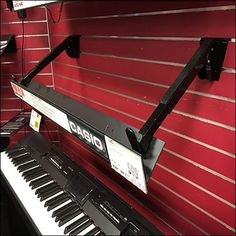 These Casio Keyboard Declined Slatwall Faceouts allow Perimeter Wall merchandising of an array of instruments without cluttering the central space. Slat Wall, Musical, Casio, Keyboard, Hooks, Waterfall, Instruments, Retail, Museum