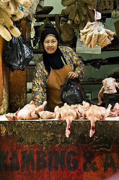 Surabaya, Indonesia - The Market's Vendors by Mio Cade