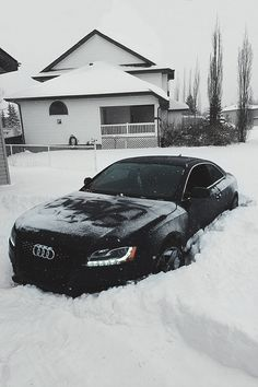 Black carbon fibre Audi A5, still look as good covered in snow