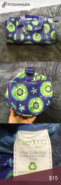 "Mixed Bag Small Duffle Bag Mixed Bag small duffle bag.  Purple sand dollar pattern.  Made from recycled material.  Hardly used.  Great condition.  Strap drop is approximately 16"" (maximum) but can be adjusted. Bags"