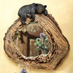 This mirror adds just the right distinction to any wall or home decor.The hollowed log slice and resting black bear in a painted polyresin frame accentuates any room by simply placing it against a wa