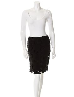 Miu Miu Black skirt with cut outs and side button closures.