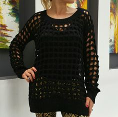 """Sexy black sweater NWT Brand new with tags.  Sexy see-thru black knitted sweater. Wear a tank top or favorite fashion bra under this sweater, pair with leggings or jeans and you are looking ooooh so HOT and sexy!!   Black knitted with large openings as seen in photos, tank top not included. Loose fitting Material 100 % acrylic Length approx 20"""" Bust side to side is approx 20"""" Size s/m (fits a small or medium, loose fitting sweater) (I am modeling this sweater, I am 5'1"""", 105lbs and bust…"""