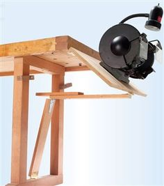 My bench grinder is out of the way but instantly accessible, thanks to this sturdy flip-up table. It works great and it's simple to make. Woodworking Guide, Woodworking Magazine, Popular Woodworking, Custom Woodworking, Woodworking Projects Plans, Garage Organisation, Workshop Organization, Bench Grinder Stand, Tool Stand
