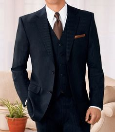 Navy pinstripe w brown tie via the style of a guy