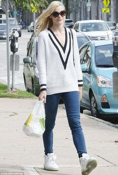 cd5b1ab54dd6 Jaime King pairs cricket-inspired jumper with hidden wedge trainers