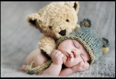 whose giving these cuddles baby or teddy