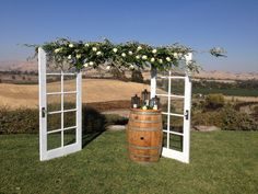 DIY arbor with doors and olive tree branches  Couple created for a hilltop wedding at our wedding venue