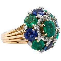 French 1950s Emerald Sapphire Peacock Dome Ring   From a unique collection of vintage dome rings at https://www.1stdibs.com/jewelry/rings/dome-rings/