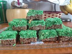 """Minecraft Ricekrispie Treats  Super easy to make.   Use a basic Rice Krispie treat recipe. Use Coco Krispie for the """"dirt"""", after you've mixed in the marshmallow mixture, spread in a rectangular baking tray.   Use regular Rice Krispies for the top. Dye them green with food dye before adding the marshmallow mixture. Once they're a nice green (and you've added the marshmallow mixture), spread on top of the Coco Krispies. Let them set for a few hours or overnight.   Cut them into squares and…"""
