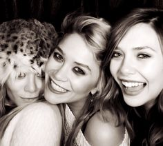 All the olsen girls. I LOVE that the olsen twins are actually smiling here!!! so much prettier than their normal look of death. LOL. Gorgeous girls, all three :))