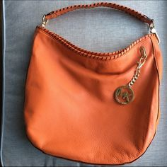 Brand new Michael Kora bag Brand new Michael Kors burnt orange bag. Still has tissue paper in the pockets! Gorgeous color and perfect condition. Michael Kors Bags Shoulder Bags