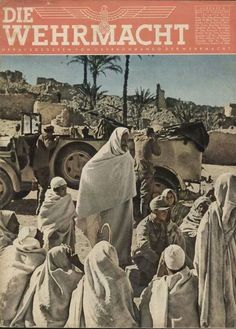 """The 1943 edition of the German military magazine """"Die Wehrmacht"""" which depicts German soldiers mingling with the local populace while stationed in North Africa. 1943 was the final year of the German expeditionary force known as 'Afrika Korps' and their operations against British and Commonwealth forces in the region. The resources and manpower of the North African campaign were reassigned to the mainland, particularly on the Eastern Front."""