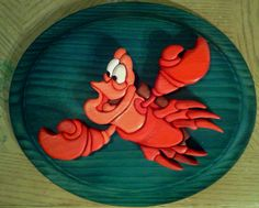 Sebastian the Crab wood intarsia. Cut, shaped, stained, assembled and glued by yours truly 8 )