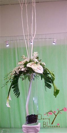 High arrangement with white anthuriums ~ Cherrie Silverman AIFD AAF CPF