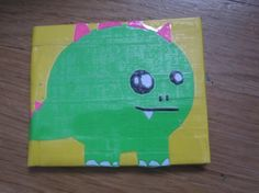 Yellow and white dinosaur duct tape wallet by TapeTown on Etsy, $7.00