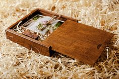 Wooden box with sections for 4x6 sized prints and USB flashdrive  Color - dark wood    Size of the box: 180x180x40 mm  USB flashdrive type: 2.0
