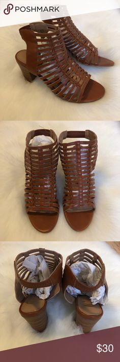 Brown Strappy Peep Toe Block Heels Brand new without tags Never worn Purchased from Charming Charlie Great with jeans or a dress Strappy design on the front Stretchy ankle strap  Block heel  Block wedge Size 7 Heel measurement in photos Charming Charlie Shoes