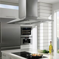 Faber 36 Inch Dama Isola Island Chimney Hood with Internal Blower, Blue LED Backlit Electronic Controls, Halogen Lights and Mesh Filters: 600 CFM Decor, Halogen Lighting, Blowers, Island Range Hood, Island With Stove, Lights, Stainless Steel Island, Kitchen Appliances, Double Wall Oven
