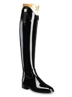 Tucci Dressage VITTORIA-ATall boot in black patent leather with rigid leg, front zipper,steel back leg insert and Swarovski crystal. Italian calfskin with an entirely rigid reinforced boot leg. Custom made,  Luxury riding wear. Large range of customization and monogramming available. Italian craftsmanship at its maximum expression. http://www.francotucci.com/en/product/vittoria-a/