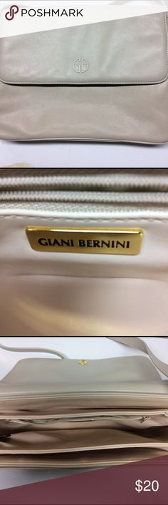 GIANI BERNINI LEATHER PURSE Gorgeous cream color shoulder bag by GIANI Bernini. Genuine All Leather materials. With polished brass accents. This bag has room for everything you need to take along with five large compartments and one zippered pouch.  In very nice condition. Smoke and pet free. Willing to bundle items. See photos for more details. Giani Bernini Bags Shoulder Bags