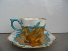 Antique Coalport blue Turquoise with gold cup& saucer