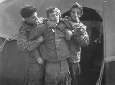George Luz (on the right) jokes around with two other soldiers