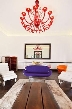 purple couch red chandelier
