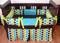 William Baby Bedding  This custom baby bedding set includes the bumper, blanket, and crib skirt. The bumper pad features the turquoise/teal, lime, black, and white dots, ultra soft turquoise and black minky , lime and white stripe, and lime grosgrain ribbon ties. The crib skirt features the dots with a tailored box pleat.  The blanket  includes dots and stripes front with a soft minky edging and backing.