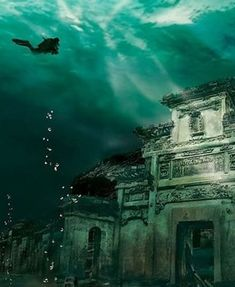 Have you ever wondered if there really was an underwater city that you could go and see? There is, Shi Cheng is a city that unfortunately sank into a Qiandao lake in China. Many divers like to go and see what is left of the city. Places To Travel, Places To See, Travel Destinations, Atlantis, Qiandao Lake, Places Around The World, Around The Worlds, Underwater Ruins, Sunken City