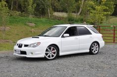 """This is a 2006-07 Subaru Impreza WRX Wagon. Sporting a new 2.5L engine, this car produces almost the same Horse Power as the 2002-2005 WRX wagon but in addition to the larger engine sports a new front end """"tri grill"""" as well as projector headlights."""
