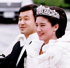Japanese Crown Princely Wedding Tiara~ The tiara's dominant elements are the large, curling diamond scrolls that make up the majority of the piece. Diamond ribbons trail through the base of the scrolls, and small floral-esque buttons sit at the point where the scrolls meet. The buttons are evoke the Chrysanthemum, an important symbol of the Japanese monarchy.