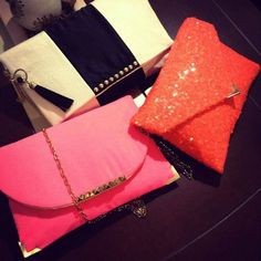 pink and orange Clutch bag
