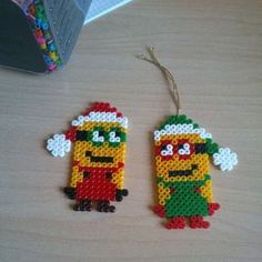 Christmas Minions hama perler beads by annina_inwonderland Melty Bead Patterns, Bead Embroidery Patterns, Pearler Bead Patterns, Perler Patterns, Beading Patterns, Loom Patterns, Jewelry Patterns, Art Patterns, Crafts