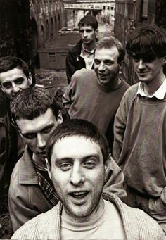The Happy Mondays in Clerkenwell London - clockwise from back Paul Davis, Mark Day, gary Whelan, Shaun Ryder, Matk 'Bez' Berry, Paul Ryder. This picture was taken in 1987 when they had released or were about to release the splendidly named ' Squirrel and G-Man Twenty Four Hour Party People Plastic Face Carnt Smile (White Out)'