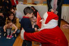 Santa distributing gifts at the ECC Christmas event