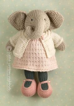 Knitted elephant doll, in a dress.