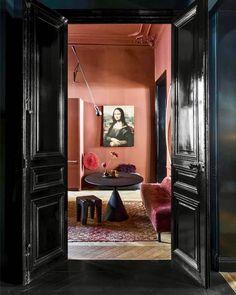 Pink interior walls hidden by black door entrance