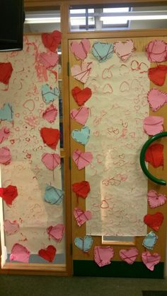Valentines display. Cut out hearts, hole punched and red threading.