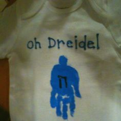 Hanukkah shirt.  Handprint dreidels made by my children!