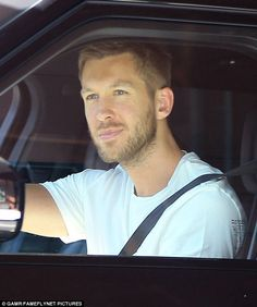 Moving on: Calvin Harris was spotted driving himself around to appointment on Friday in Beverly Hills, California after splitting from pop star Taylor Swift earlier in the week