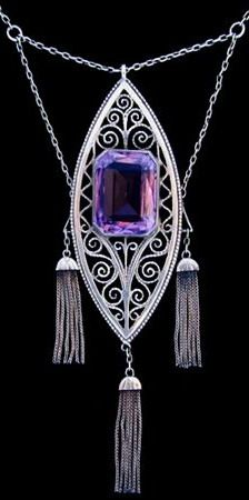 THEODOR FAHRNER A fine silver pendant set with a large central amethyst. German c.1900. Obscured mark to clasp and '935' 'depose'. Size: Height of pendant 8.7 cm. Width 2.7 cm.