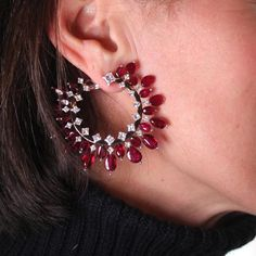 Alexandre Reza's hoop earrings are set with rare ruby 'pebbles' from Mozambique in the most desirably pigeon's blood colour