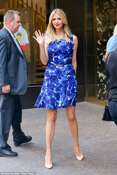 Snapping back to shape: The businesswoman absolutely stunned in a form-fitting blue floral dress which flaunted her tiny midriff and lean tanned legs