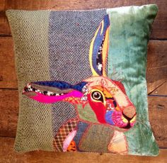 Hand made appliqued pillow, of a hare on a velvet, tweed and green background. A unique item individually designed. Very chic country style....:
