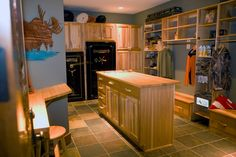 Custom+Gun+Room+Design   photo of the hunters' prep room with gun safes and dressing area with ...